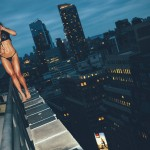 Kyra on a building's edge by George Vordos